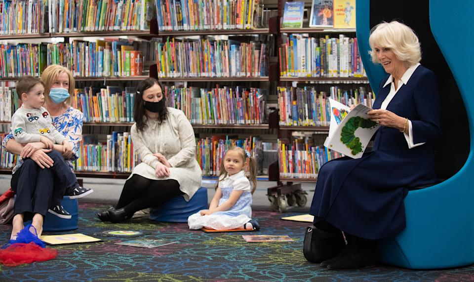 The Duchess of Cornwall reading the Very Hungry Caterpillar to children.