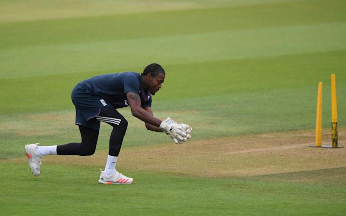 England's Jofra Archer wears keeping gloves as he trains ahead of the second day of the second cricket Test match between England and Pakistan, at the Ageas Bowl in Southampton, England, Friday, Aug. 14, 2020. - AL
