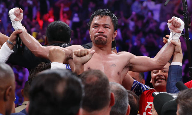 Manny Pacquiao reacts after defeating Keith Thurman by split decision in a welterweight title fight Saturday, July 20, 2019, in Las Vegas. (AP Photo/John Locher)