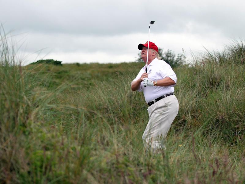 Donald Trump plays a round of golf after the opening of the Trump International Golf Links Course on 10 July, 2012, in Balmedie, Scotland: Ian MacNicol/Getty Images