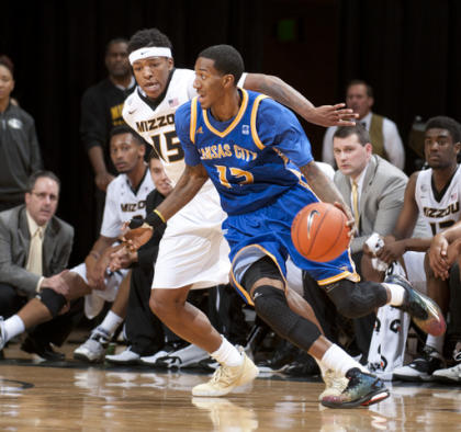 UMKC's Frank Williams Jr. dribbles around Missouri's Wes Clark (AP)
