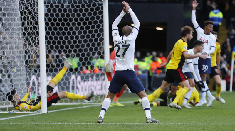 Watford's Ignacio Pussetto, left, saves on the net line during the English Premier League soccer match between Watford and Tottenham Hotspur at Vicarage Road, Watford, England, Saturday, Jan. 18, 2020. (AP Photo/Frank Augstein)