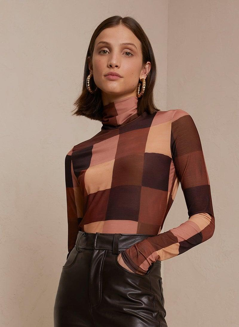 <p>I can't think of a more playful and super fall-friendly way to tap into the checkered trend than by opting for this <span>James Mock Neck Jersey Top</span> ($250). The color palette makes it ideal to pair with any bottom.</p>