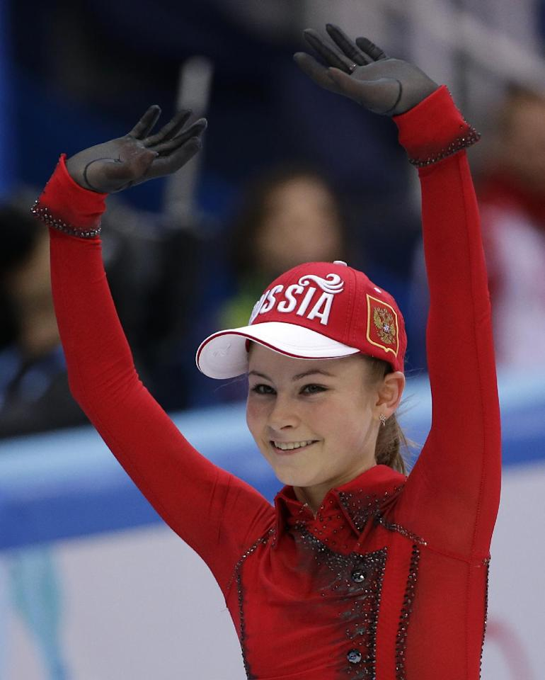 Julia Lipnitskaia of Russia waves to spectators after competing in the women's team free skate figure skating competition at the Iceberg Skating Palace during the 2014 Winter Olympics, Sunday, Feb. 9, 2014, in Sochi, Russia. (AP Photo/David J. Phillip)