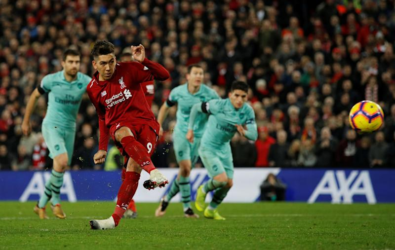 """Soccer Football - Premier League - Liverpool v Arsenal - Anfield, Liverpool, Britain - December 29, 2018 Liverpool's Roberto Firmino scores their fifth goal from the penalty spot to complete his hat-trick REUTERS/Phil Noble EDITORIAL USE ONLY. No use with unauthorized audio, video, data, fixture lists, club/league logos or """"live"""" services. Online in-match use limited to 75 images, no video emulation. No use in betting, games or single club/league/player publications. Please contact your account representative for further details."""