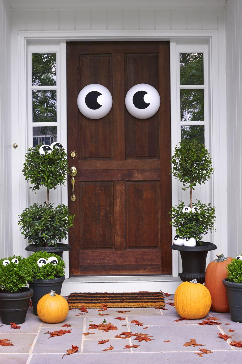"""<p>Here's one adorable way to let trick-or-treaters know that you're keeping an eye on them.</p><p><em><a href=""""https://www.womansday.com/home/decorating/g1279/easy-halloween-decorations/"""" rel=""""nofollow noopener"""" target=""""_blank"""" data-ylk=""""slk:Get the tutorial at Woman's Day »"""" class=""""link rapid-noclick-resp"""">Get the tutorial at Woman's Day »</a></em> </p>"""