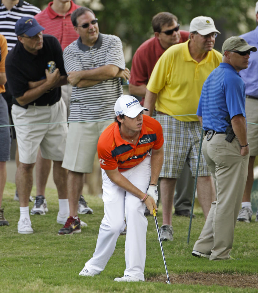 Rory McIlroy, of Northern Ireland, watches his shot from the rough on the 17th hole at the St. Jude Classic golf tournament on Friday, June 8, 2012, in Memphis, Tenn. McIlroy finished the second round at 7-under-par 133. (AP Photo/Mark Humphrey)