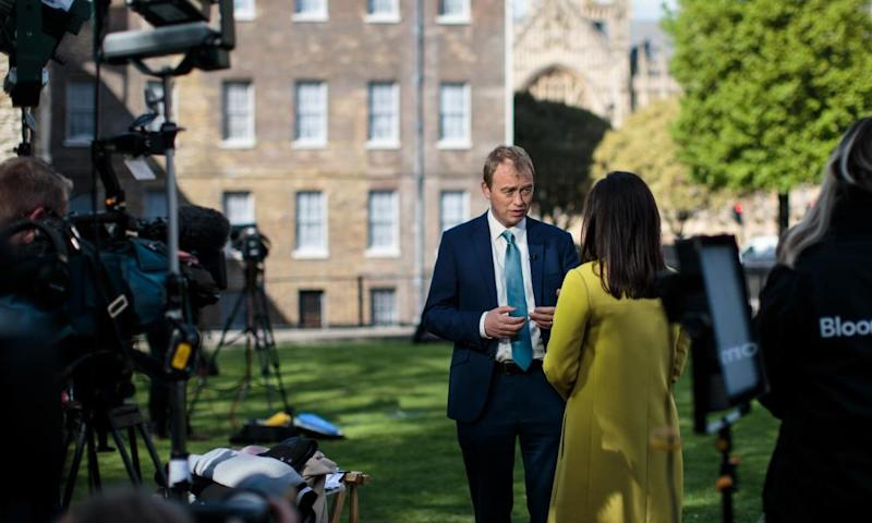 Liberal Democrat Leader Tim Farron (C) gives an interview to media on College Green in Westminster