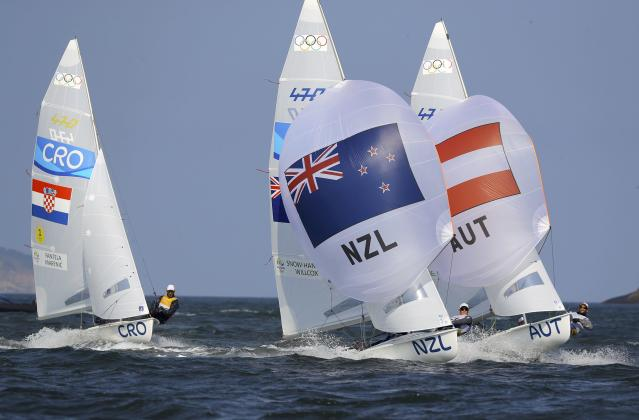 2016 Rio Olympics - Sailing - Final - Men's Two Person Dinghy - 470 - Medal Race - Marina de Gloria-Rio de Janeiro, Brazil - 18/08/2016. Sime Fantela (CRO) of Croatia and Igor Marenic (CRO) of Croatia, Paul Snow-Hansen (NZL) of New Zealand and Daniel Willcox (NZL) of New Zealand and Matthias Schmid (AUT) of Austria and Florian Reichstadter (AUT) of Austria compete. REUTERS/Brian Snyder FOR EDITORIAL USE ONLY. NOT FOR SALE FOR MARKETING OR ADVERTISING CAMPAIGNS.