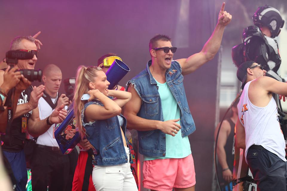 "Rob Gronkowski and Camille Kostek are seen on stage during ""Gronk Beach"" at North Beach Bandshell & Beach Bowl in Miami, Florida."