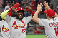 CORRECTS TO DOUBLE, INSTEAD OF SINGLE - St. Louis Cardinals' Marcell Ozuna (23) celebrates his two-run double against the Atlanta Braves in the ninth inning during Game 1 of a best-of-five National League Division Series, Thursday, Oct. 3, 2019, in Atlanta. (AP Photo/John Bazemore)