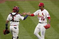 St. Louis Cardinals relief pitcher Alex Reyes (29) and catcher Yadier Molina (4) celebrate after defeating the Milwaukee Brewers in a baseball game Thursday, April 8, 2021, in St. Louis. (AP Photo/Jeff Roberson)