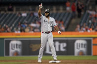 Chicago White Sox's Eloy Jimenez reacts to hitting a one-run double against the Detroit Tigers in the third inning of a baseball game in Detroit, Monday, Sept. 20, 2021. (AP Photo/Paul Sancya)