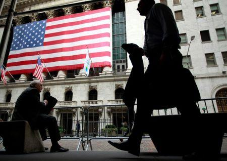 FILE PHOTO -  Morning commuters are seen outside the New York Stock Exchange