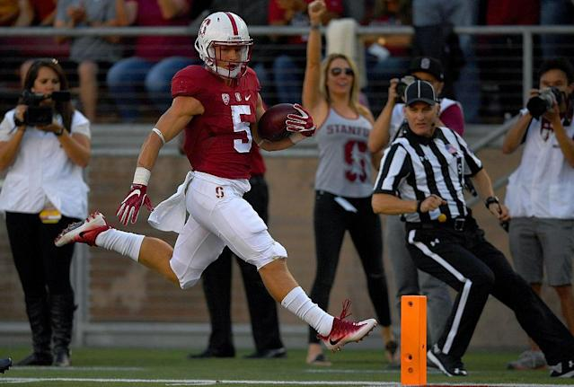 Christian McCaffrey #5 of the Stanford Cardinal scores a touchdown against the USC Trojans in the first half. (Getty Images)
