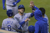 Kansas City Royals' Hunter Dozier, middle, is congratulated by teammates after scoring against the Oakland Athletics during the seventh inning of a baseball game in Oakland, Calif., Thursday, June 10, 2021. (AP Photo/Jeff Chiu)