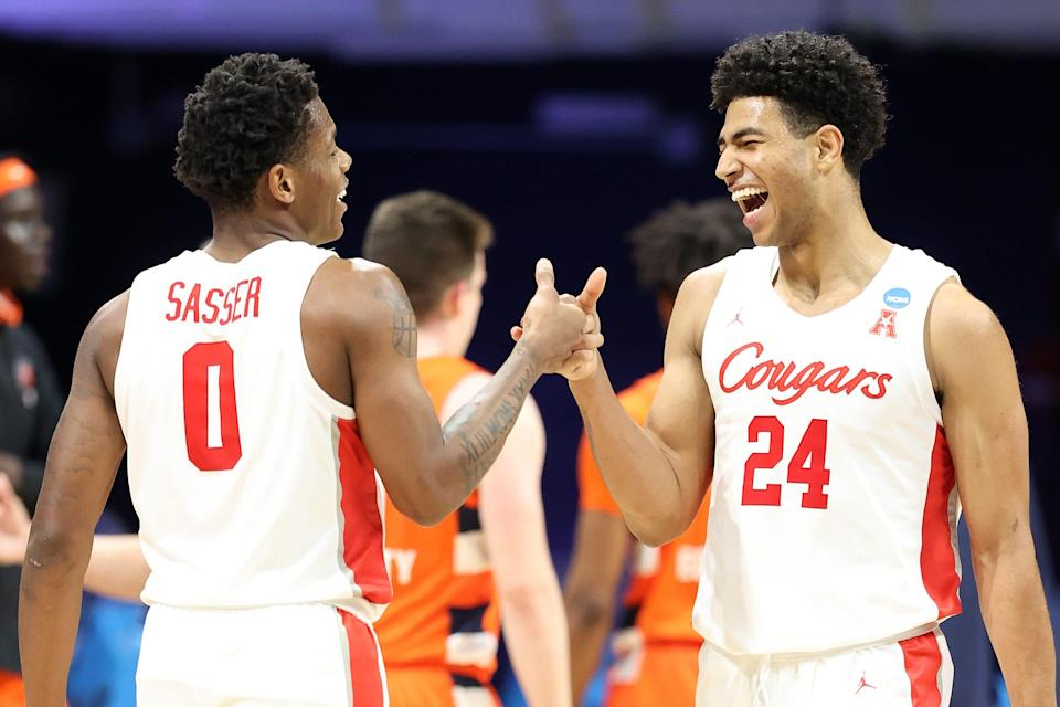 Marcus Sasser and Quentin Grimes of the Houston Cougars react in the second half of their Sweet Sixteen game against the Syracuse Orange in the 2021 NCAA Men's Basketball Tournament at Hinkle Fieldhouse.