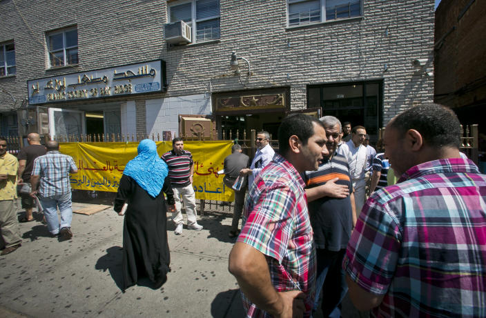 Visitors socialize outside the Islamic Society of Bay Ridge and mosque, after a Jumu'ah prayer service on Friday, Aug. 16, 2013, in the Brooklyn borough of New York. The New York Police Department targeted the mosque as a part of a terrorism enterprise investigation beginning in 2003, spying on it for years. The mosque has never been charged as part of a terrorism conspiracy. (AP Photo/Bebeto Matthews)