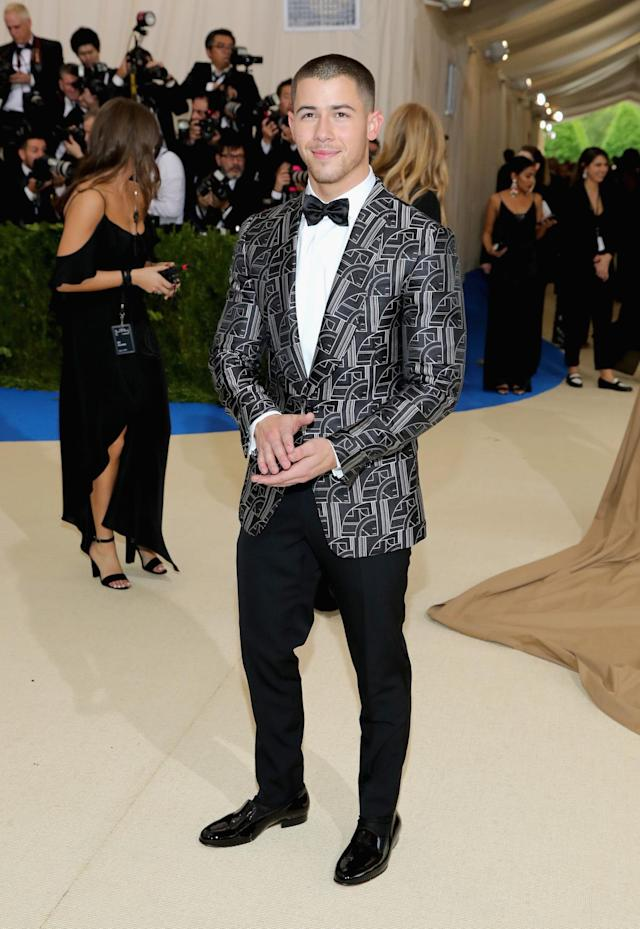 <p>The singer wore a black and white tuxedo jacket from Ralph Lauren Purple Label with black tuxedo pants to the 2017 Met Gala. (Photo by Neilson Barnard/Getty Images) </p>