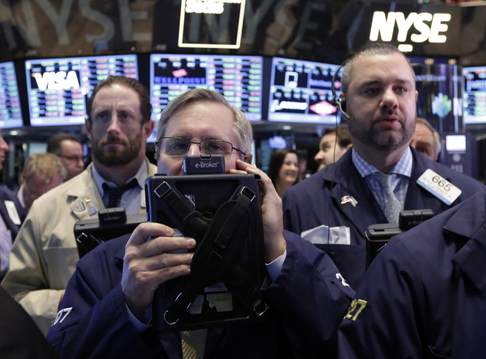 Traders work on the floor of the New York Stock Exchange, Thursday, Dec. 12, 2013. Lower U.S. stock prices on Thursday set up investors for what would be their third day in a row of declines. (AP Photo/Richard Drew)