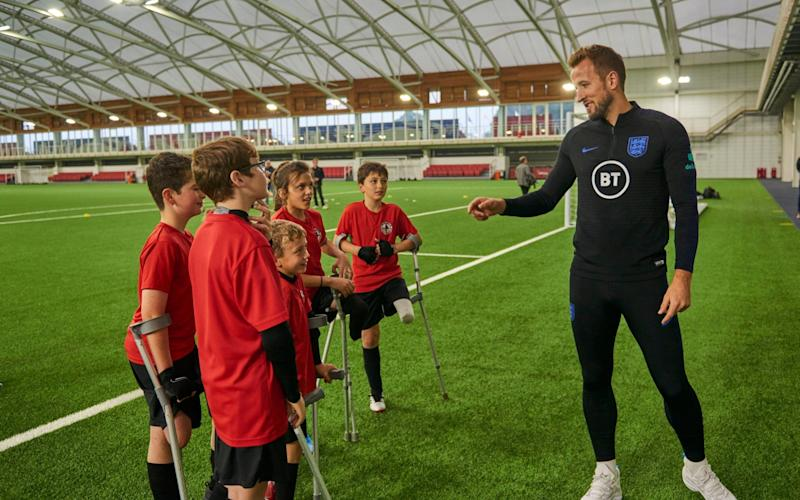 Footballer Harry Kane with children from the England Amputee Football Association - WARNING: Use of this copyright image is subject to the terms of use of BBC Pictures' Digital Picture