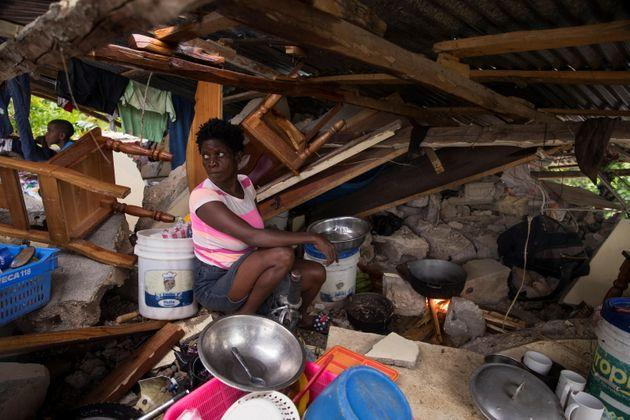 epa09418125 A woman sits amid the debris of her house, while the rain falls during the passage of tropical storm Grace, in Camp Perrin, Haiti, 17 August 2021. Heavy rains fell on southwestern Haiti, the area most affected by the 7.2 magnitude earthquake on the Richter scale that on 14 August caused more than 1,400 deaths and 6,900 injuries.  EPA/Orlando Barria (Photo: Orlando Barria EPA)