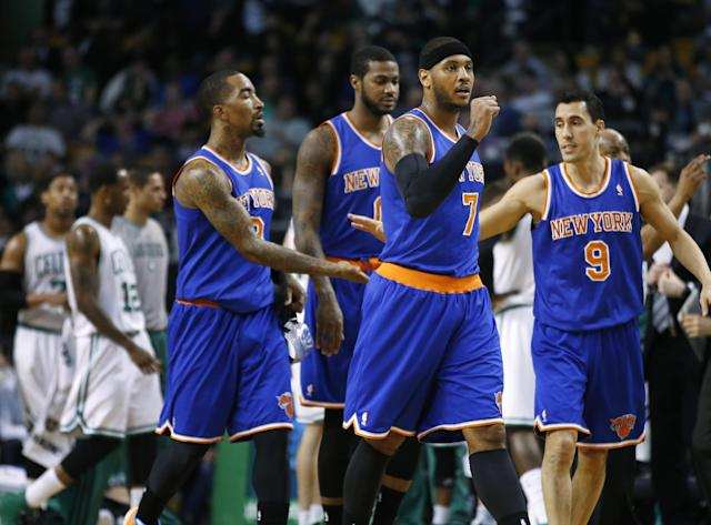New York Knicks forward Carmelo Anthony (7) makes a fist as he leads his team off the court for a timeout in the first quarter of an NBA basketball game against the Boston Celtics in Boston, Wednesday, March 12, 2014. (AP Photo/Elise Amendola)