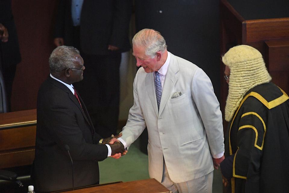 HONIARA, GUADALCANAL ISLAND, SOLOMON ISLANDS - NOVEMBER 25:  Prince Charles, Prince of Wales meets Members of Parliament after addressing the National Parliament of the Solomon Islands at Parliament House during day three of the royal visit to the Solomon Islands on November 25, 2019 in Honiara, Guadalcanal Island, Solomon Islands. The Prince of Wales and Duchess of Cornwall just finished a tour of New Zealand. It was their third joint visit to New Zealand and first in four years. The Prince is currently on a solo three day tour of The Solomon Islands. (Photo by  Victoria Jones - Pool/Getty Images)