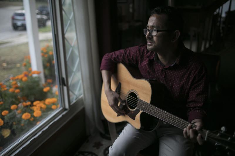 Amber Subba plays music at home in Cuyahoga Falls, Ohio.
