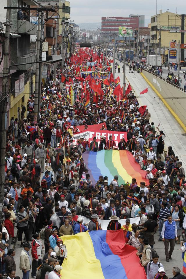 Indigenous people march to protest President Rafael Correa's policies on mining as they pass near the National Assembly in Quito, Ecuador, Thursday, March 22, 2012. Protesters reached Ecuador's capital on Thursday after a two-week march from the Amazon to oppose plans for large-scaling mining projects on their lands. (AP Photo/Dolores Ochoa)