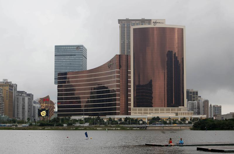 """FILE - In this Wednesday, April 21, 2010 file photo, the Wynn Encore Macau, right, stands next to the Wynn Macau, left in center, in Macau. The Chinese arm of Wynn Resorts Ltd. said it received approval on Wednesday, May 2, 2012 for a new casino in the Cotai district of Macau, the world's most lucrative gambling market. Wynn Resorts founder, chairman and CEO Steve Wynn said the Cotai development is the """"single most important project"""" in his company's history. (AP Photo/Kin Cheung, File)"""