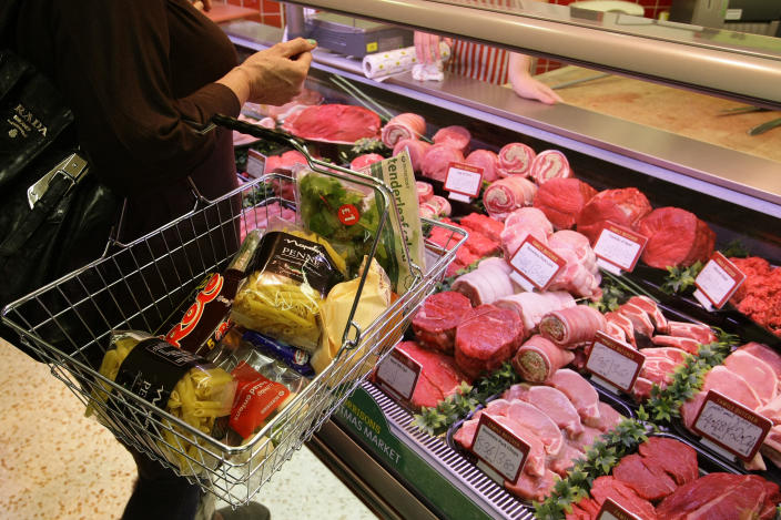 A customer shops at a Morrisons store in Welling, south-east London. Photo: Stefan Wermuth/Reuters