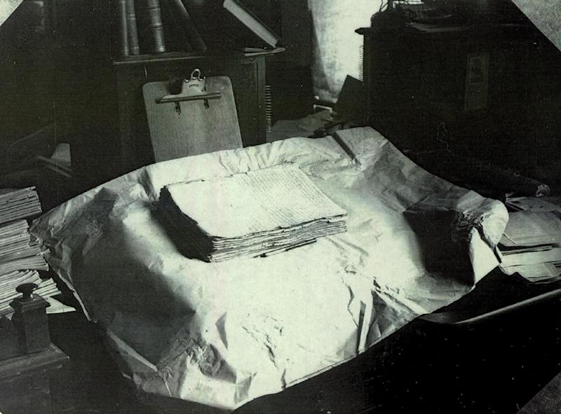 The printer's manuscript of the Book of Mormon rests on a table in this early 20th-century photograph.  (Intellectual Reserve Inc)
