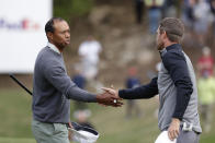 Tiger Woods, left, shakes hands with Lucas Bjerregaard after their quarterfinal match at the Dell Technologies Match Play Championship golf tournament, Saturday, March 30, 2019, in Austin, Texas. Woods lost the match to Lucas Bjerregaard. (AP Photo/Eric Gay)