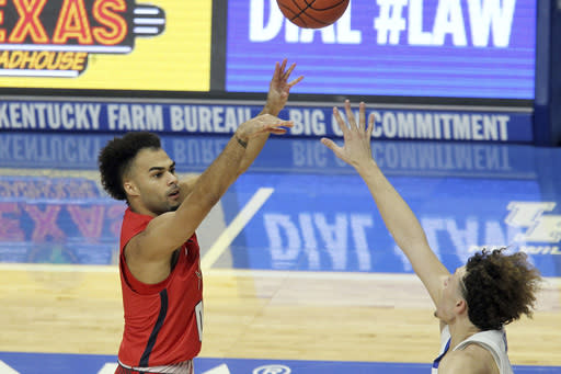 Richmond's Jacob Gilyard, left, shoots while defended by Kentucky's Devin Askew during the first half of an NCAA college basketball game in Lexington, Ky., Sunday, Nov. 29, 2020. (AP Photo/James Crisp)