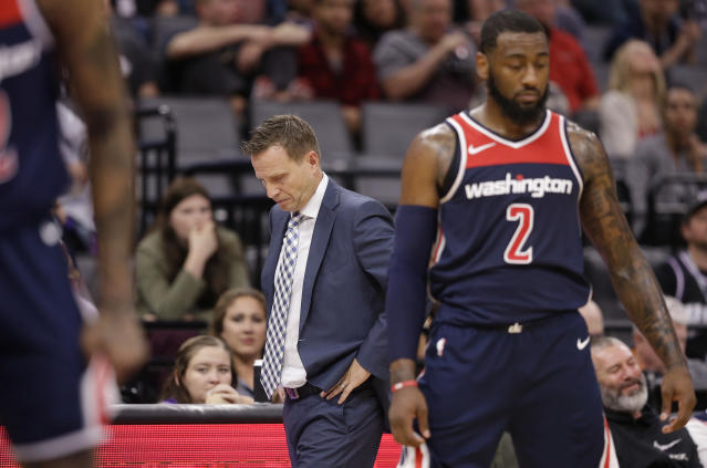 Scott Brooks (left), John Wall and the Wizards have limped to a 1-5 record to start the NBA season. (AP)