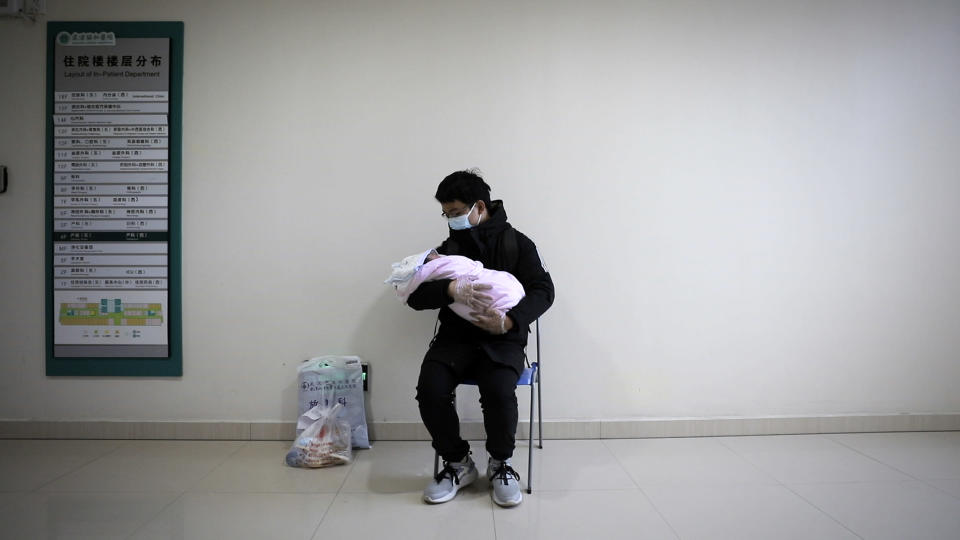 "A man holds his newborn baby in hospital during the peak of the COVID-19 outbreak in Wuhan, China in a scene from the documentary ""76 Days."" The film, shot in four Wuhan hospitals, captures a local horror before it became a global nightmare. Given the constraints at the time on footage and information from Wuhan, it's a rare window into the infancy of the pandemic. (MTV Documentary Films via AP)"