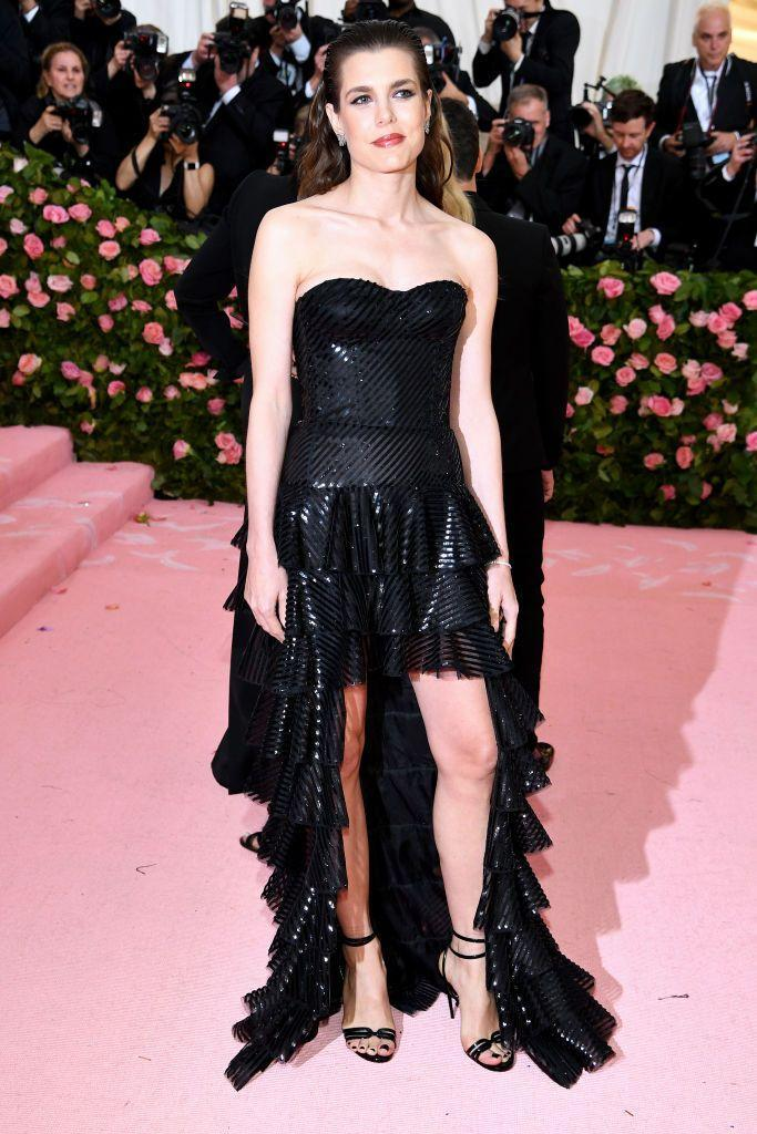 <p>Often at the forefront of fashion, Charlotte has been the face of both Gucci and Yves Saint Laurent. She attended the 2019 Met Gala in Saint Laurent, opting for this edgy, high-low gown. </p>