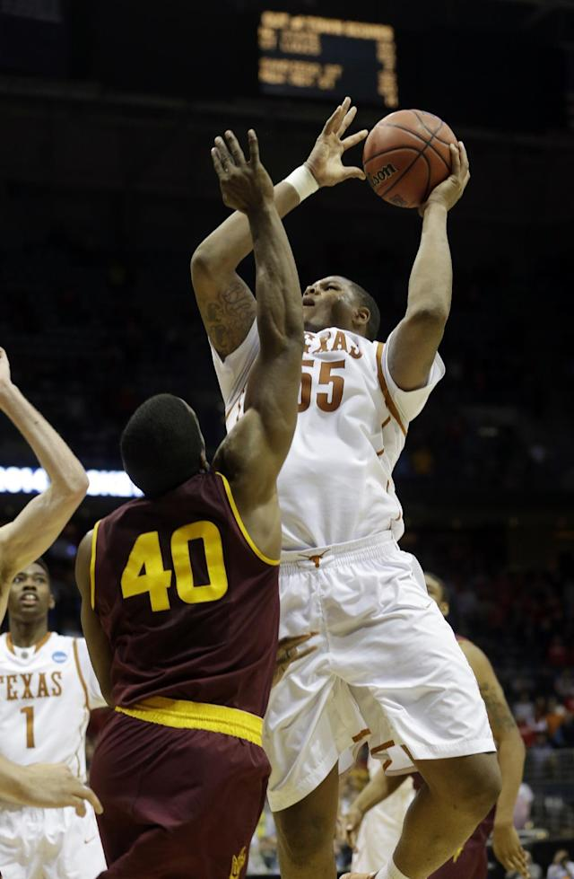 Texas center Cameron Ridley (55) goes up to make the game winning shot against Arizona State guard Shaquielle McKissic (40) during the second half of a second-round game in the NCAA college basketball tournament Thursday, March 20, 2014, in Milwaukee. Texas won 87-85. (AP Photo/Morry Gash)