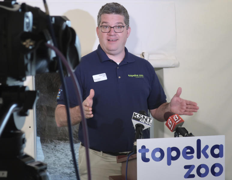 Brendan Wiley, director of the Topeka, Kansas, Zoo, speaks to reporters during a news conference, Tuesday, April 23, 2019, about a tiger attack that seriously injured a veteran zookeeper at the zoo in Topeka, Kan. Wiley says the zookeeper and the tiger should not have been in the open part of the tiger's enclosure at the same time and acknowledges that human error is probably to blame. (AP Photo/John Hanna)