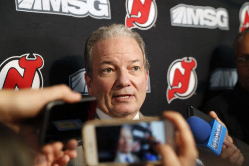 New Jersey Devils General Manager Ray Shero speaks to members of the media before an NHL hockey game against the Vegas Golden Knights, Tuesday, Dec. 3, 2019, in Newark, N.J. The Devils let go of head coach John Hynes earlier Tuesday and named Alain Nasreddine interim head coach. (AP Photo/Kathy Willens)