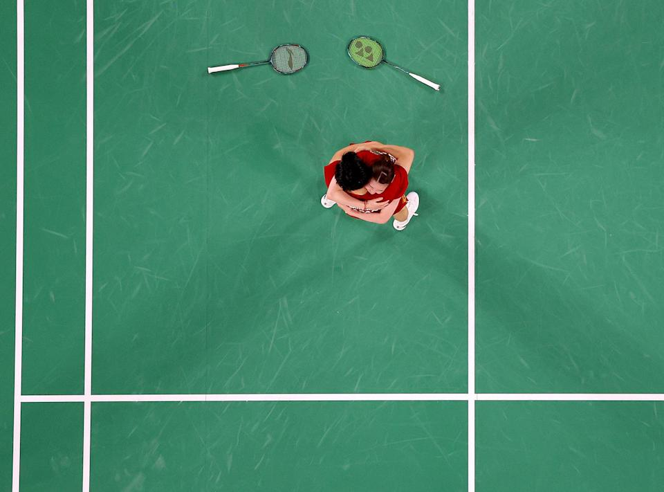 <p>Yuta Watanabe (left) and Arisa Higashino of Japan celebrate after winning the mix doubles bronze medal badminton match on day seven of the Games.</p>