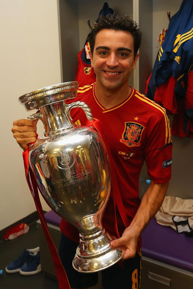 KIEV, UKRAINE - JULY 01: Xavi Hernandez of Spain poses with the trophy in the dressing room following the UEFA EURO 2012 final match between Spain and Italy at the Olympic Stadium on July 1, 2012 in Kiev, Ukraine. (Photo by Handout/UEFA via Getty Images)