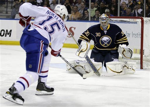 Buffalo Sabres goalie Ryan Miller makes a save on a shot by Montreal Canadiens' Petteri Nokelainen (15), of Finland, during the second period of an NHL hockey game in Buffalo, N.Y., Wednesday, March 21, 2012. (AP Photo/David Duprey)