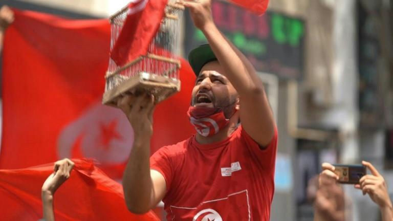 Horns blare in Tunisia after president suspends parliament and dismisses PM