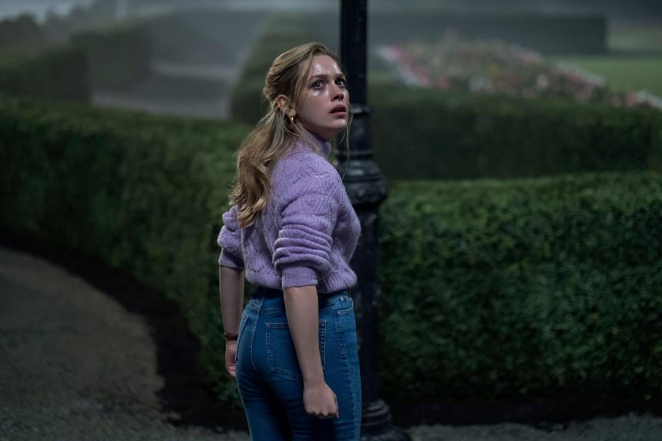 """Victoria Pedretti stars as a nanny to two children who sees some ghostly goings-on at her new job in Netflix's """"The Haunting of Bly Manor."""""""