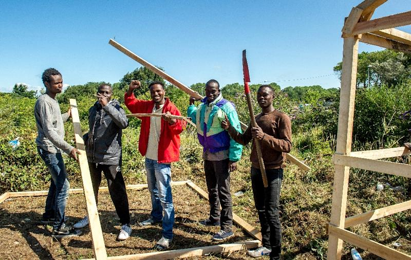 "Migrants from Sudan build a hut at a site dubbed ""new jungle"" -- where migrants trying to reach Britain have camped out near Calais, on July 29, 2015 (AFP Photo/Philippe Huguen)"