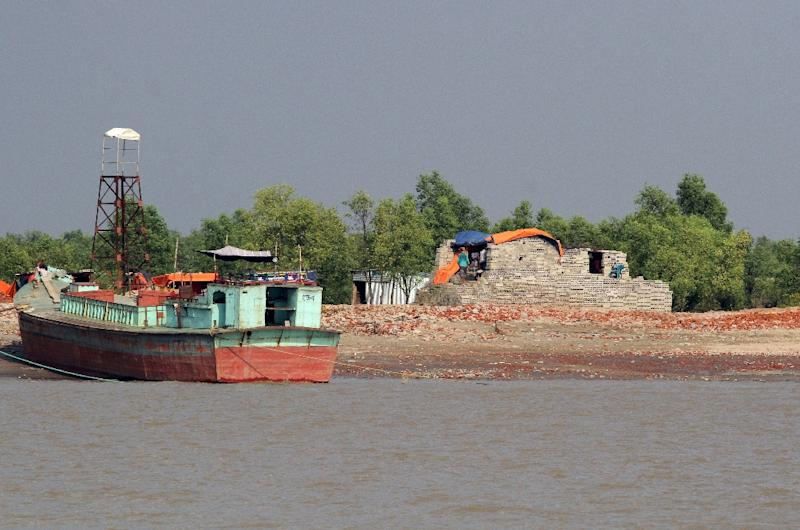 Dhaka says shifting 100,000 refugees to the muddy silt islet of Bhashan Char in the Bay of Bengal will take pressure off overcrowded camps along its southern border