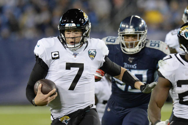 FLE - In this Nov. 24, 2019, file photo, Jacksonville Jaguars quarterback Nick Foles (7) scrambles against the Tennessee Titans in the second half of an NFL football game in Nashville, Tenn. A person familiar with the trade says the Jacksonville Jaguars have agreed to send quarterback Nick Foles to the Chicago Bears for a compensatory fourth-round draft pick. The person spoke to The Associated Press on condition of anonymity because trades don't become official until the league year begins later Wednesday, March 18, 2020. (AP Photo/Mark Zaleski, File)