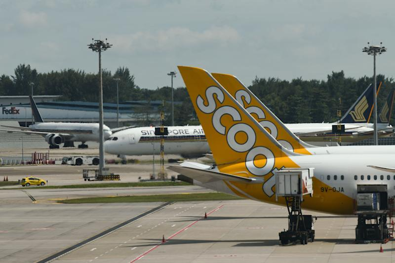 The aircrafts of Scoot and Singapore airlines are seen at Singapore international airport on January 30, 2020. (Photo by Roslan RAHMAN / AFP) (Photo by ROSLAN RAHMAN/AFP via Getty Images)
